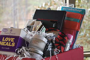 Beauty Basket containing $50 Sephora Gift card and free makeover, Chanel perfume, Fresh lip gloss, face cream, facial mask, and more.