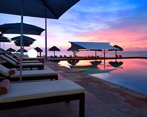 Cancun Coastal Adventure for 2, 4 nights at Westin Resort & Spa, RT airfare for 2, Parasailing, Snorkeling Catamaran Cruise